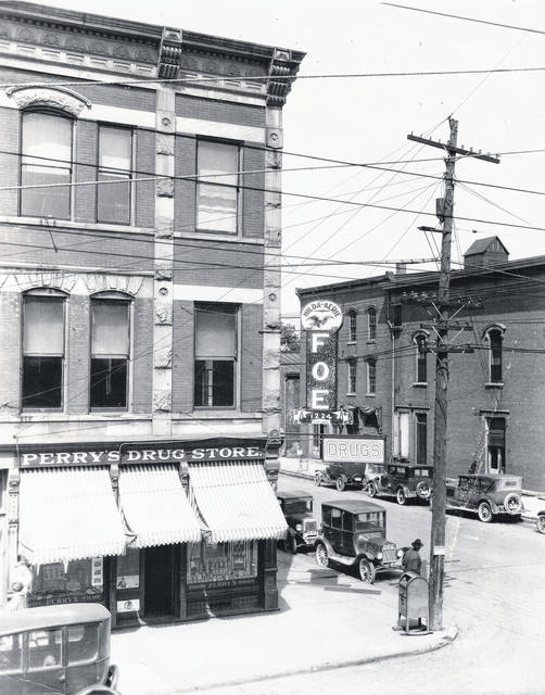 "This undated photo of downtown Wilmington focuses on Perry's Drug Store and the Fraternal Order of Eagles (FOE) #1224 Hilda Aerie. Can you tell us more about this photo? Let us know at info@wnewsj.com. Thank you to reader Becky Thumma who filled us in on some information about last week's photo of the Wilmington buses and their drivers. Becky is the daughter of Harold VanDervort of VanDervort Transportation. She said that Mr. VanDervort is third from right, and Andy DeBoard is fifth from right. Third from left is Lawrence Frump (""Frumpie"", as he was called) and Vaughn Reynolds is in back of him."