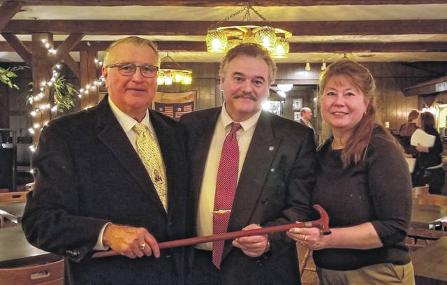 From left, Gary Kersey, GOP Chairman Tim Inwood, and Dr. Mary Lou Inwood holding a cane made from wood taken from the Lincoln birthplace cabin.