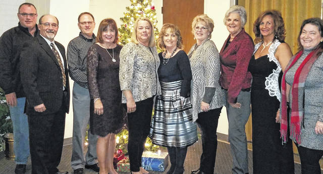 <strong>Award of Distinction</strong>: $1 million and higher &#8212; From left are Larry Britain, Steve Riehle, Brian Prickett, Marsha Bennett, Robyn Clifton, Sheri McIntosh, Connie Gray, Brenda Barr, Cheri Honnerlaw and Sue Walker. Not pictured are Leah Grant and Bradley Cochran.