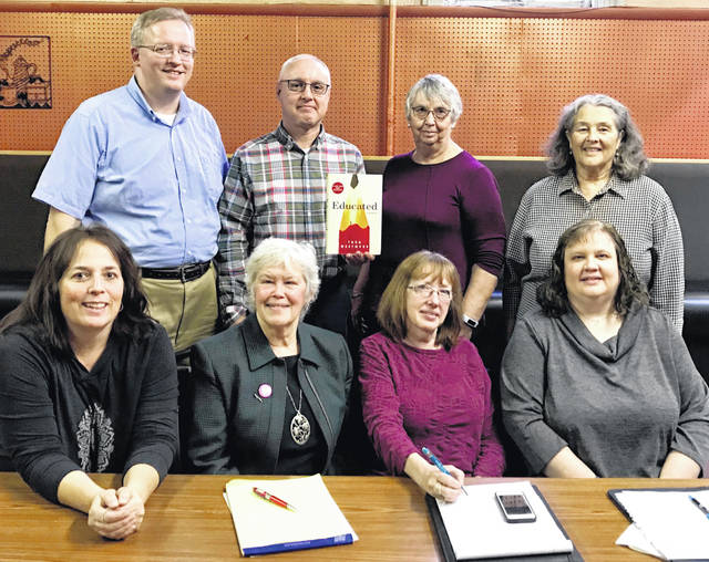 Clinton County Reads steering committee members are, from left: front row, Eileen Brady, Mary Thomas Watts, Joy Brubaker, and Peggy Dunn; back row, Joe Knueven, Chris Owens, Bonnie Starcher, and Marla Stewart.