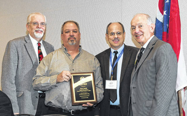 Gary Smith with his safety award presented by CEAO Executive Director Dean Ringle (left), outgoing CEAO President Paul Gruner (right), and Clinton County Engineer and new CEAO President Jeff Linkous.