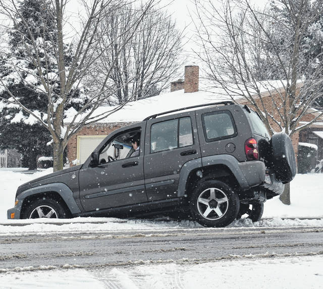 Some Good Samaritans helped a motorist whose SUV slid off South Nelson Road in Wilmington on a snowy and wet Thursday morning. There were no injuries.