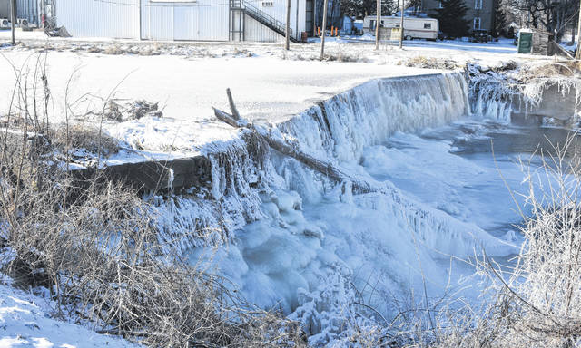 While some water flows at the dam next to Joe Beam & Sons Mill in Port William on Thursday, most remains frozen due to the sub-zero temperatures in the area this week. The weekend is expected to bring a significant warm-up to Clinton County.