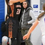 WHS girls put defensive clamps on Massie