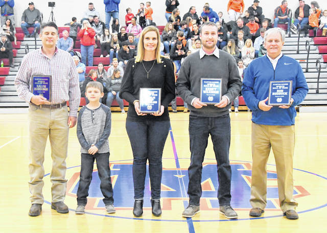 The 2019 Class of the Clinton-Massie Athletic Hall of Fame was inducted Friday night prior to the varsity boys basketball game against Wilmington. The inductees were Ron Rudduck, Kerry Wilkinson, Natalie Kemp Harmeling and Ralph Robinson. From left to right in the photo are Matt and Luke Robinson representing Ralph Robinson, Harmeling, Wilkinson and Rudduck.