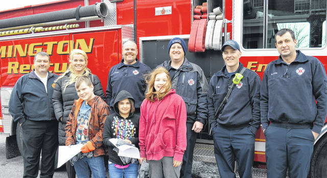 The winning fifth-graders in the WFD reading contest are, from left in the front, Trever Shultz, Joslynn Cook and Kiara Cook. From left in the back are Wilmington Fire Chief Andy Mason, East End Elementary Principal Jen Martin, and Wilmington firefighters Jack Coates, Jeff Haines, Rick Birt and Brent Terrell.