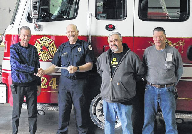 From left are Sabina Moose Lodge 1224 Trustee Bud Nelson, SRWW Joint Fire District Chief Chuck Gaskins, Moose Lodge Administrator Dean Scholler and Moose Lodge Trustee Scott Smith.