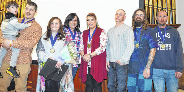 The seven new You-Turn Recovery Docket graduates are, from left, Tommy Grimes, Crystal Hamm, Erica Johnson, Donna Lancen, Ricky Johnson, Bruce Bennett, and Chris Fisher.