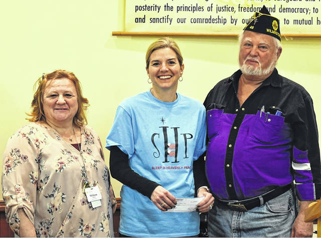 American Legion Post 49 Commander Jim Cook recently presented a check for $3,500 to Carrie Zeigler, Wilmington Chapter Co-President of Sleep in Heavenly Peace. The money will be used to buy materials to make beds for those local children who currently do not have an adequate sleeping environment. Also pictured, at left, is Melissa Puckett.