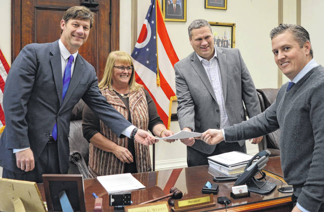 A landmark moment calls for a photo opportunity. Celebrating the establishment of the Clinton County Legacy Fund are Clinton County Commissioners Kerry R. Steed, Brenda K. Woods and Michael McCarty, joined by Clinton County Assistant Prosecuting Attorney Andrew McCoy, the county's legal counsel.