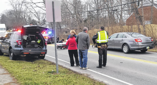 A pedestrian was transported via CareFlight to Miami Valley Hospital in Dayton after the woman, Michelle Evans, 49, of Wilmington, and a family dog were struck by a vehicle on West Truesdell Street near Holmes Elementary in Wilmington around 8:15 a.m. Thursday. Evans was apparently retrieving the loose dog when they were struck by a Ford Taurus sedan, according to Police Chief Duane Weyand. The driver was Frank Rineair, 61, 0f Blanchester; he stopped and remained on the scene. The dog was deceased at the scene. Weyand said the accident remains under investigation, and no citations or charges have been issued at this time. Evans reportedly had several injuries; her condition was not yet available from the hospital.