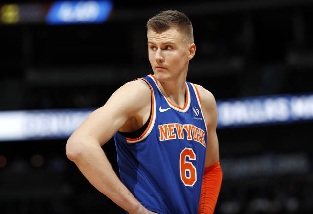 FILE - In this Jan. 25, 2018, file photo, New York Knicks forward Kristaps Porzingis, of Latvia, reacts after fouling out during the second half of the team's NBA basketball game against the Denver Nuggets on Thursday,, in Denver. The Knicks agree to trade injured star Kristaps Porzingis to Dallas Mavericks on Thursday, Jan. 31, 2019. (AP Photo/David Zalubowski, File)