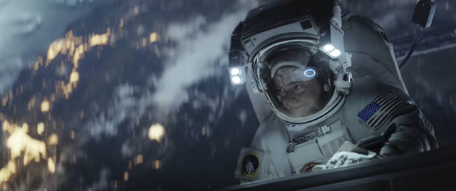 This undated image made from a video provided by Amazon shows a scene from the company's 2019 Super Bowl NFL football spot featuring Scott Kelly. Amazon pokes fun at itself as celebrities from Harrison Ford to astronaut twins Mark and Scott Kelly test products that didn't quite work out, including an electric toothbrush and a dog collar with Amazon's Alexa digital assistant. (Amazon via AP)