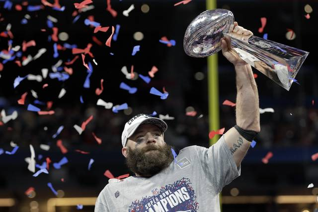 New England Patriots' Julian Edelman holds the trophy after the NFL Super Bowl 53 football game against the Los Angeles Rams, Sunday, Feb. 3, 2019, in Atlanta. The Patriots won 13-3. Edelman was named the Most Valuable Player. (AP Photo/David J. Phillip)