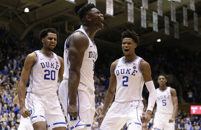 Duke's Zion Williamson, center, reacts with Marques Bolden (20), Cam Reddish (2) and RJ Barrett (5) following a play against St. John's during the second half of an NCAA college basketball game in Durham, N.C., Saturday, Feb. 2, 2019. Duke won 91-61. (AP Photo/Gerry Broome)