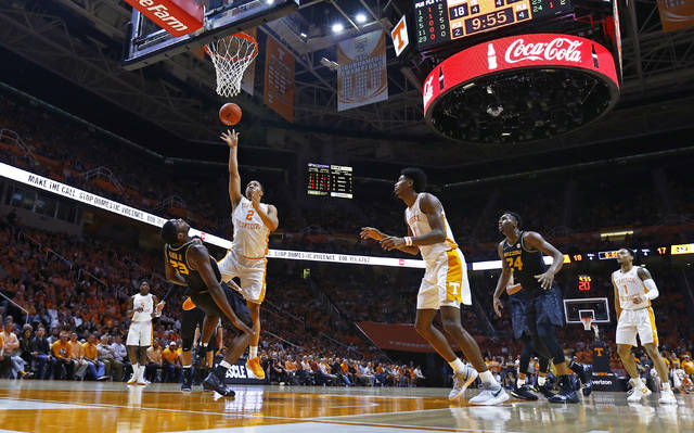Tennessee forward Grant Williams (2) shoots as he collides with Missouri forward Jeremiah Tilmon (23) during the first half of an NCAA college basketball game Tuesday, Feb. 5, 2019, in Knoxville, Tenn. (AP photo/Wade Payne)