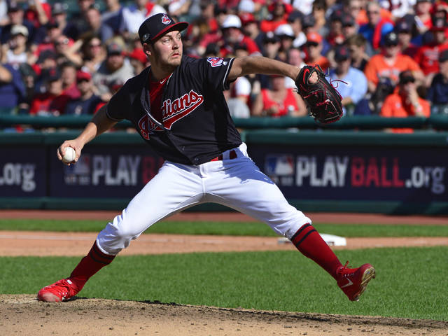 File-This Oct. 8, 2018, file photo shows Cleveland Indians starting pitcher Trevor Bauer delivering in the sixth inning during Game 3 of a baseball American League Division Series against the Houston Astros, in Cleveland. Bauer won his arbitration hearing for the second straight year and was awarded $13 million instead of the Cleveland Indians' $11 million offer on Wednesday, Feb. 13, 2019, by James Darby, James Oldham and Sylvia Skratek. (AP Photo/Phil Long, File)