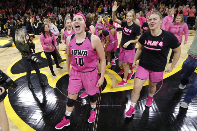Iowa forward Megan Gustafson (10) celebrates with teammates after an NCAA college basketball game against Maryland, Sunday, Feb. 17, 2019, in Iowa City, Iowa. Gustafson scored 31 points as Iowa won 86-73. (AP Photo/Charlie Neibergall)