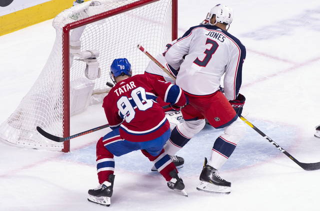 Montreal Canadiens left wing Tomas Tatar (90) scores past Columbus Blue Jackets goaltender Sergei Bobrovsky as defenceman Seth Jones looks on during third period NHL hockey action in Montreal on Tuesday, Feb. 19, 2019. (Paul Chiasson/The Canadian Press via AP)