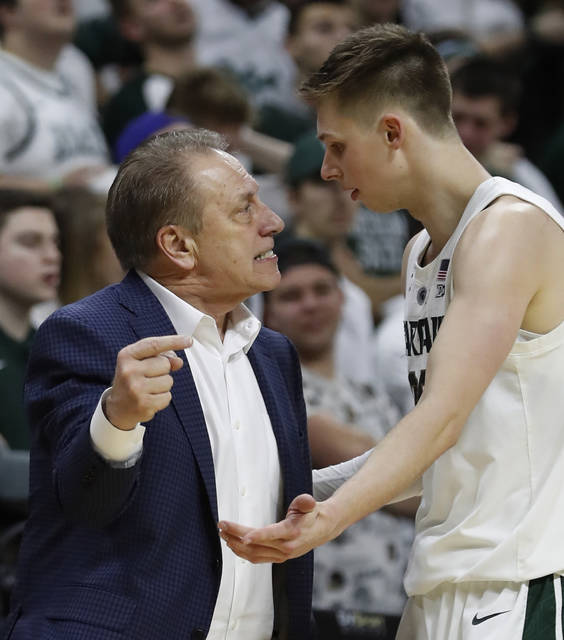 Michigan State coach Tom Izzo has a talk with guard Matt McQuaid during the second half of the team's NCAA college basketball game against Rutgers, Wednesday, Feb. 20, 2019, in East Lansing, Mich. (AP Photo/Carlos Osorio)