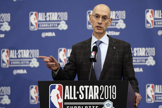"FILE - In this Feb. 16, 2019, file photo, NBA Commissioner Adam Silver speaks during NBA All-Star festivities in Charlotte, N.C. A person with knowledge of the matter says that the NBA recently sent a proposal to the National Basketball Players Association about lowering the minimum age to enter the NBA Draft from 19 to 18, as the sides continuing moving toward eliminating the ""one-and-done"" policy that has many elite players going to college for one season. (AP Photo/Gerry Broome, File)"