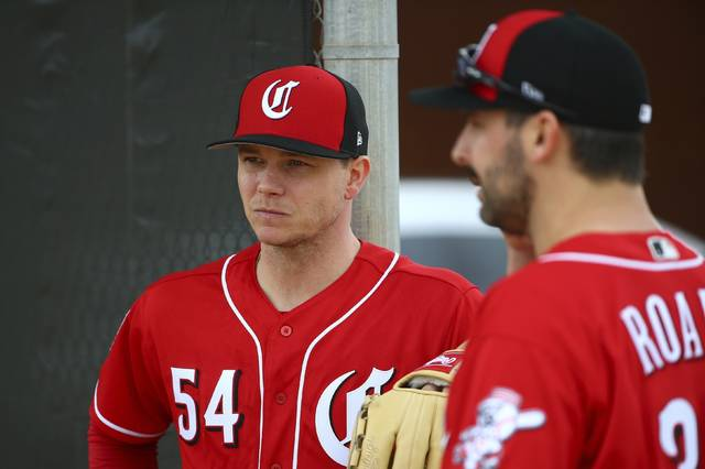 FILE - In this Feb. 13, 2019, file photo, Cincinnati Reds pitcher Sonny Gray (54) and Tanner Roark pause during workouts at the Reds spring training baseball facility, in Goodyear, Ariz. Gray agreed to a trade from the Yankees after deciding he wanted to be part of the Reds' attempt at a resurgence. Now they have to figure out where he fits in the rotation. (AP Photo/Ross D. Franklin, File)
