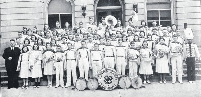 "The Clinton County 4-H Concert Band played at the World's Poultry Congress in Cleveland in July 1939 as well as at the Ohio State Fair. Pictured in front of the Clinton County Courthouse are, from left: first row, Director A. Glen Snell, Kathryn Snider, Vernadine Runyan, Cleo Kirk, Stanley Sharp, Robert Morrow, Robert Flint, Allan Brown, Richard Smith, Richard Swindler, Charles Carey, Evelyn Morrow, Virginia Hamilton, Richard Clayton, and Harry Miars; second row, Wesley Haines, Janet Spurgeon, Charlotte Pugsley, Norma Jean Nunn, Barbara Peterson, Robert Terrell, Richard Lundy, Williams Kearns, George Hartley, Vivian Putman, Vivian Larrick and Betty Ellen Hamilton; third row, Earl Hadley, Margaret Hurst, William Carr, Mary Page, Eloise Lynch, Mary Emily Luse, Janet Beam, Janet Cramer, Dorothy Larrick, Anna Louise Mathews, Marilyn Miller, Mary Jane Peterson, Robert McCoy and Philip Garinger; fourth row, Harlan Foltz, Phyllis Brindle, Margaret Terrell, Barbara Thornburg, Mildred Hust, Glen Fox, Robert Swindler, Frances Phelps, Thomas Powers, Thomas McMillan, Eugene Mitchell, Frankie George, Herbert Kaufman Jr. and Helen Louise Kaufman; and, back row, Avonell Dome, Annabel Parker, Rosellen Fisher, Everett Beam, Kathleen Brindle, Tom Page, Louis Kelsey, Thomas Cornett, James Terrell, Jack Crites, Nancy Terrell and Warren Powers. (Names/spellings are from the publication ""1920-1995 Commitment to Community: Clinton County"")"