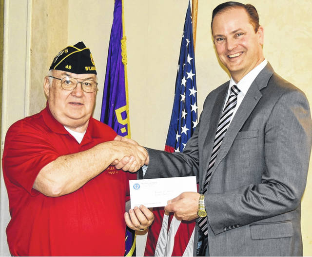 Members of Wilmington veterans organizations were on hand for the Annual Friends of Scouting luncheon. Presenting checks to the Tecumseh Area Council Scouting Executive were American Legion Post 49 Scouting and Youth Activities Chairman Charles Rose and VFW Post 6710 Commander Richard James.
