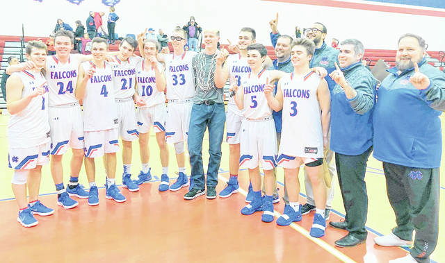 The Clinton-Massie varsity boys basketball team won the SBAAC American Division championship this season. They travel to SBAAC National Division champion Georgetown Friday night for the league's annual Bud Phillips Scholarship crossover game. Team members and coaches are, from left to right, Daulton Wolfe, Griffin Laake, Zach Chowning, Nate Baker, Tate Olberding, Drew Settlemyre, Thomas Myers, Spencer Voss, Austin Faucett, head coach Todd Cook, Brenden Lamb, coach Will Tyler, coach Steven Gerber, coach Greg Ledford.