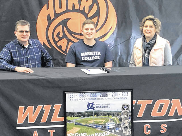 "Wilmington High School senior Alex Meyer has decided to continue his academic and athletic baseball career at Marietta College. WHS coach Brian Roberts said, ""We knew Alex was talented when he came in and he worked hard during the season and offseason to become even better. He has really become a leader and is quick to help others. He will be successful at the collegiate level."" In the photo, from left to right, Randy Meyer, Alex Meyer, Shannon Meyer."