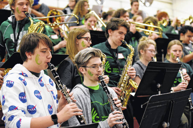Thirty band members from Blanchester, Clinton-Massie, East Clinton and Wilmington high schools joined forces with Wilmington College's Quaker Thunder Pep Band in a special night at Raizk Arena.