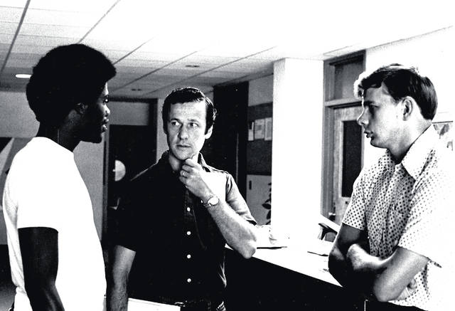 Bill Kincaid, middle, chats with two students, Heinz Finkes, Class of '74, right, and an unidentified student in this 1974 photo.