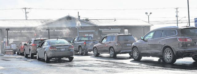 Many local residents took advantage of the warmer weather after the polar vortex earlier in the week by getting their vehicles cleaned at the Rombach Avenue car wash on Saturday.