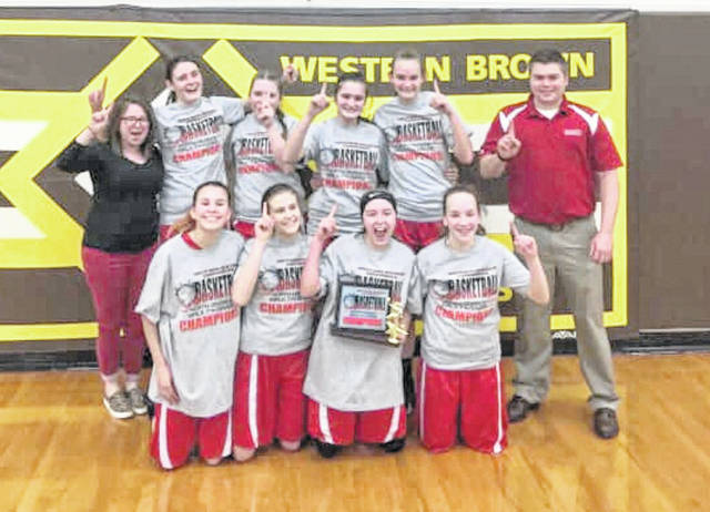 The East Clinton seventh grade girls basketball team, champions of the SBAAC Northern Division tournament, from left to right, front row, Jade Campbell, Abigail Reynolds, Jordan Collom, Megan Hadley; back row, assistant coach Tomi Chappius, Lilly Hoskins, Maddie Ferguson, Ashlyn Tate, Lauren Runyon, head coach David Boris.