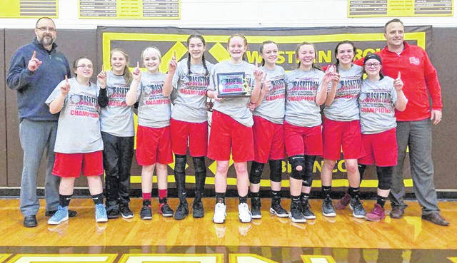 The East Clinton eighth grade girls basketball team made it two straight SBAAC Northern Division championships, defeating Wilmington in this year's tournament title game 33-23. In the photo, from left to right, coach Jason Whiteaker, Lindsey Clutter, Megan Tong, Lauren Stonewall, Libby Evanshine, Jozie Jones, Jayden Murphy, Hayleigh Perdue, Kami Whiteaker, Marinah Beener, coach Todd Runyon.