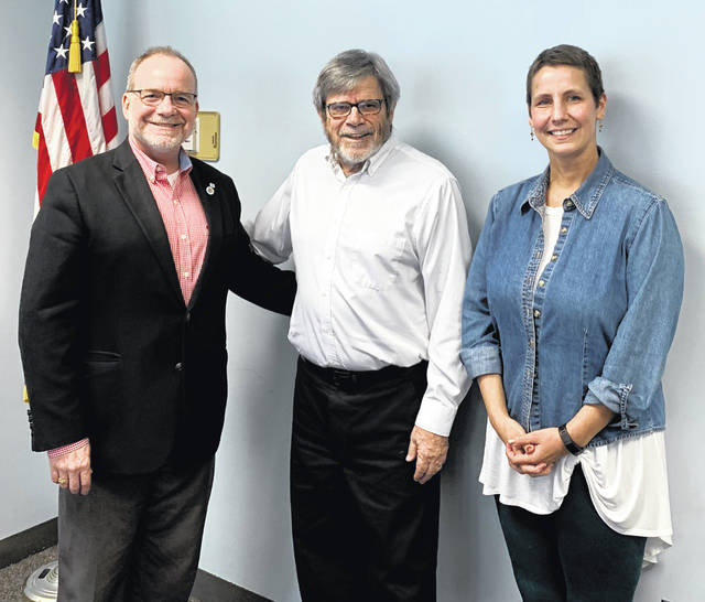 From left are Dan Evers, President of the Wilmington Rotary Club, Professor Ron Rembert, and Katherine Harrison Tigar, President-Elect of the Wilmington Rotary Club.