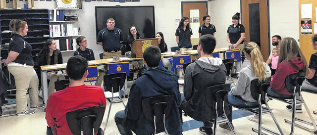 FFA officers and members conduct the February chapter meeting.