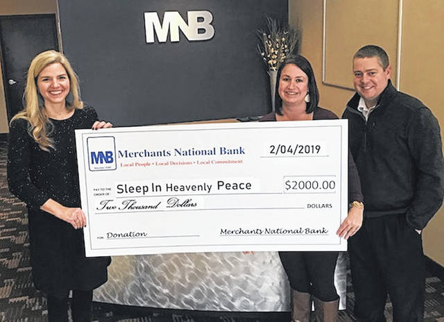 Merchants National Bank recently donated $2,000 toward Sleep in Heavenly Peace in Clinton County. Merchants National Bank will partner with Buckingham Financial Group to build 10 bunk beds helping 20 children in Clinton County. Sleep in Heavenly Peace builds beds for children who do not have beds or are sleeping in uncomfortable situations. the group is currently seeking businesses, churches or other organizations to financially support future bed builds. Shown from left are Carrie Zeigler of Sleep in Heavenly Peace, and Nikki Custis and Chad Beam, representing Merchants National Bank. For more information, contact Carrie Zeigler at 937-728-0986