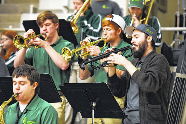 During a recent home basketball game, Band Director Stephen Wadsack, right, plays trumpet alongside Joseph Schmidt, left, and Cameron Phelps. Jordan Moore is playing alto saxophone.