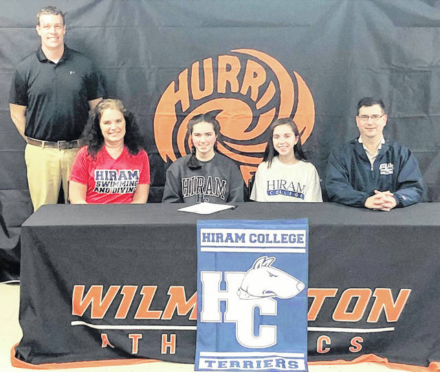 "Wilmington High School senior Carrie Robinson has chosen to continue her athletic and academic career at Hiram College, a Division III institution located in northeast Ohio. Robinson is a member of the WHS swim team. ""Carrie is a tremendous worker and has worked through adversity to get to where she is today,"" WHS swim coach Mitch Hopf said. ""I'm excited to see what the future holds for her not only in swimming, but academically as well."" In the photo, from left to right, front row, mother Heather Robinson, Carrie Robinson, sister Meredith Robinson, father Shawn Robinson; back row, coach Mitch Hopf."