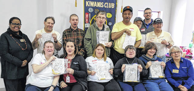 Members of Wilmington Kiwanis and the Aktion Club teamed up, with the Aktion Club making activity kits as well as sorting books.