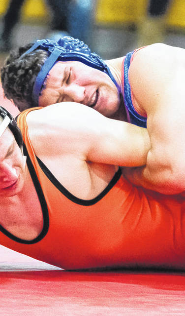 Clinton-Massie's Colton Doyle (top) will wrestle at 195 pounds in the upcoming Division II Southwest District wrestling tournament at Wilmington's Rodger O. Borror Middle School gym.