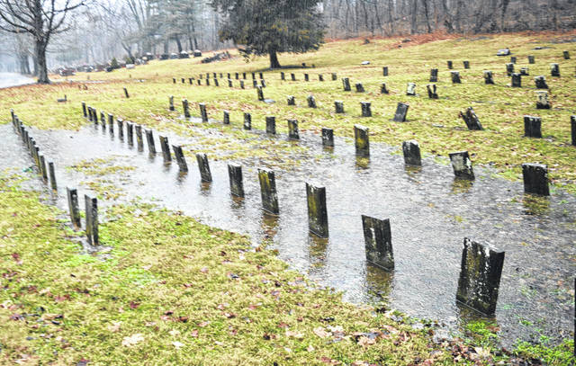 Veterans' grave markers were partly under water Thursday at Sugar Grove Cemetery in Wilmington.