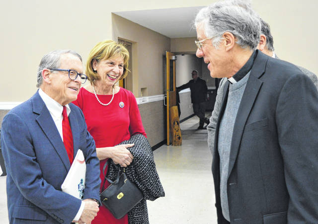 Shortly after the couple entered Expo Hall at the Clinton County Fairgrounds, from left Ohio Gov. Mike DeWine and First Lady Fran DeWine chat with Fr. Michael Holloran of the St. Columbkille Catholic Church in Wilmington.