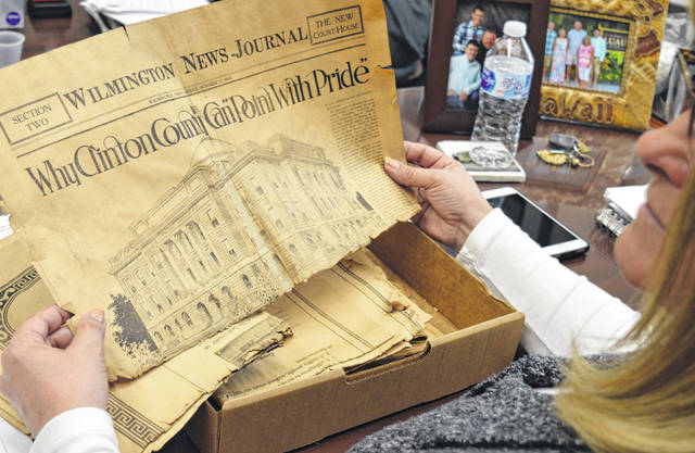 "The Jonathan McKay Family has donated to the county an original 1919 souvenir edition of the Wilmington News-Journal that celebrated the opening of the Clinton County Courthouse. A centennial event is scheduled for later this year on Saturday, Oct. 19 for the courthouse, and McKay wanted county commissioners to have the 100-year-old newspaper in connection with the courthouse anniversary. Mostly hidden but holding the front page of Section Two of the 1919 newspaper is Clinton County Commissioners President Brenda K. Woods. The yellow-with-age page includes a drawing of the courthouse exterior under a headline that states Why Clinton County Can ""Point with Pride""."