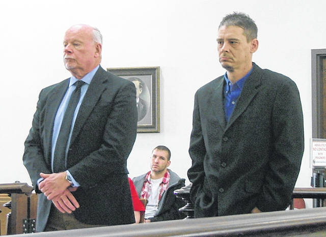 Jeremiah Eidenier, right, is shown Wednesday in Highland County Common Pleas Court with attorney Bill Armintrout.