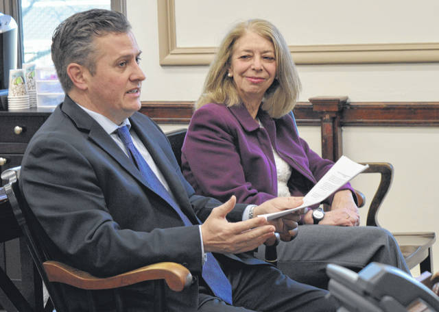 From left, Clinton County Assistant Prosecuting Attorney Andrew McCoy and Clinton County Foundation Executive Director Jan Blohm meet with county commissioners Wednesday concerning the Clinton County Legacy Fund.