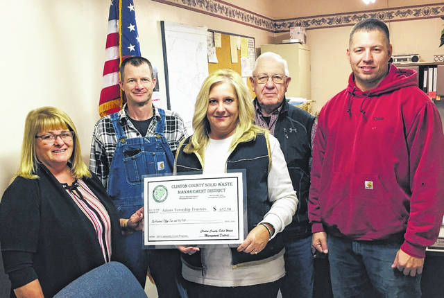 Clinton County Commissioners President Brenda Woods and Solid Waste District Coordinator Jeff Walls presented the Adams Township Trustees with a 2019 Community Grant at Monday morning's township meeting. Pictured from left are Woods, Township Trustee Chris Collett, Fiscal Officer Melinda Rose, Trustee James Reveal and Trustee Tyler Webb.