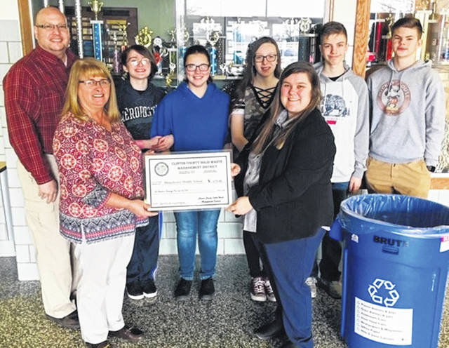 Shown presenting and receiving the 2019 PEAR Grant are, from left: front, Clinton County Commissioners President Brenda Woods and science teacher Julia Perry and, back, Solid Waste District Coordinator Jeff Walls, and students Catelyn Neeley, Katelynn Whitt, Kaylie Paugh, Nolan Wood and Zach West
