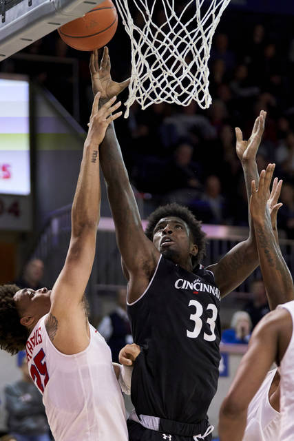 Cincinnati center Nysier Brooks (33) drives to the basket against SMU's Ethan Chargois (25) during the second half of an NCAA college basketball game Wednesday, Feb. 27, 2019, in Dallas. (AP Photo/Cooper Neill)